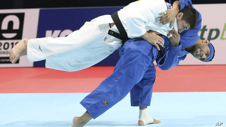 Luka Maisuradze of Georgia, top, competes against Saeid Mollaei of Iran