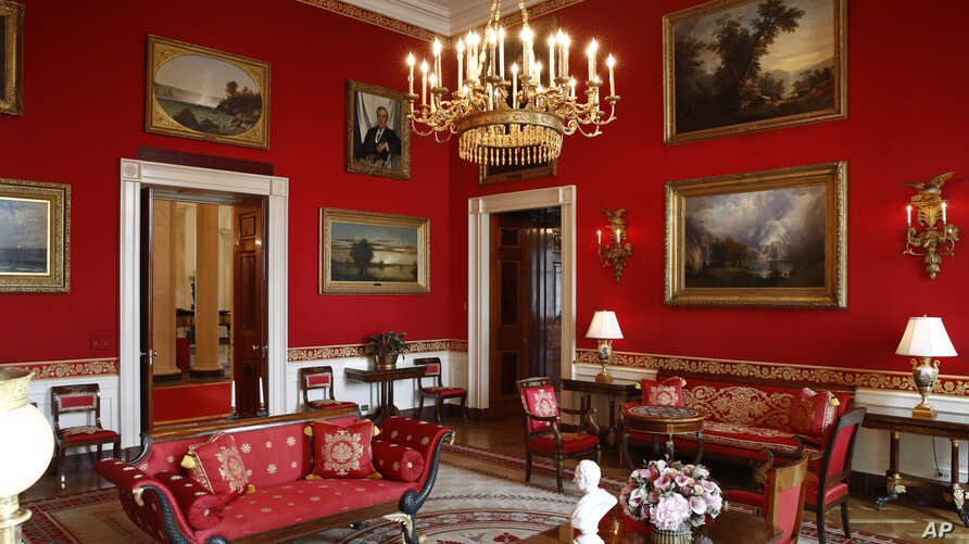 """This Sept. 17, 2019, photo shows refreshed wall fabric in the Red Room of the White House in Washington. Sunlight streaming into the Red Room had left wall fabric """"so faded it was almost pink,"""" said Stewart McLaurin, president of the White House…"""