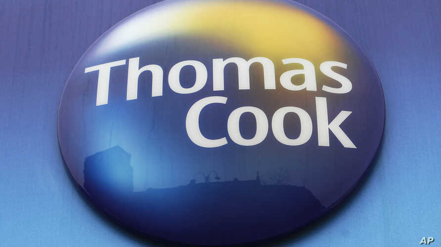 FILE - In this Tuesday, Nov. 22, 2011 file photo, a sign of Thomas Cook travel agent is seen at a branch in north London. More than 600,000 vacationers who booked through tour operator Thomas Cook were on edge Sunday, wondering if they will be able…