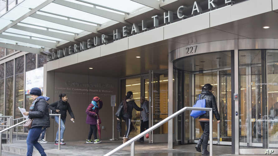 People enter New York City Health Hospitals Gouverneur Health building, Tuesday, Jan. 8, 2019, in New York. Mayor Bill de Blasio says New York City will spend up to $100 million per year to expand health care coverage to people without health…
