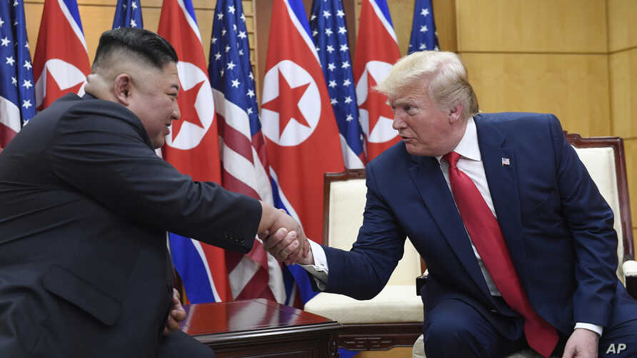 FILE - In this June 30, 2019, file photo, U.S. President Donald Trump, right, meets with North Korean leader Kim Jong Un at the border village of Panmunjom in the Demilitarized Zone, South Korea. North Korea on Friday, Sept. 27, 2019, says it wants…