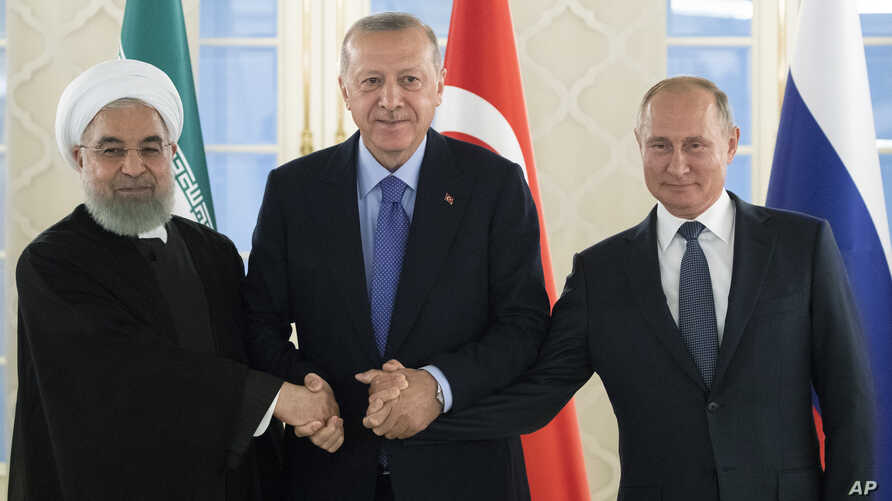 From left: Iranian President Hassan Rouhani, Turkish President Recep Tayyip Erdogan and Russian President Vladimir Putin shake hands during their meeting in Ankara, Turkey, Monday, Sept. 16, 2019. The leaders of Russia, Iran and Turkey are set to…