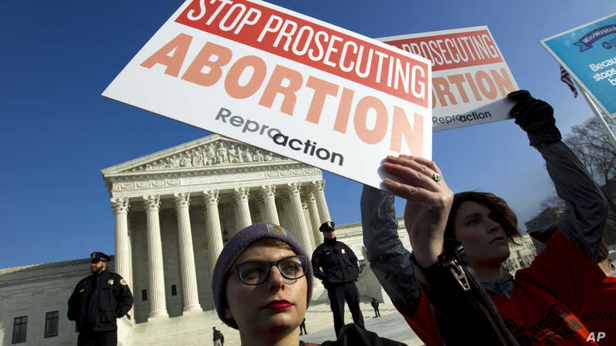 FILE - In this Jan. 18, 2019, file photo, abortion rights activists protest outside of the U.S. Supreme Court, during the March for Life in Washington. The passage of abortion restrictions in Republican-led states and a corresponding push to…