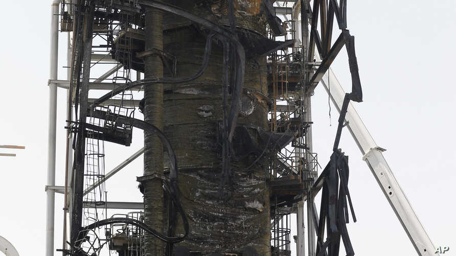 In this photo opportunity during a trip organized by Saudi information ministry, damage is seen in the Aramco's Khurais oil field, Saudi Arabia, Friday, Sept. 20, 2019, after it was hit during Sept. 14 attack. Saudi officials brought journalists…