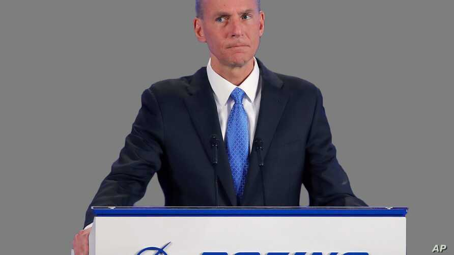 Dennis Muilenburg headshot, as Boeing Chairman, President, and CEO, graphic element on gray