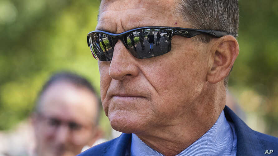 Michael Flynn, President Donald Trump's former national security adviser, leaves the federal court following a status conference with Judge Emmet Sullivan, in Washington, Tuesday, Sept. 10, 2019. (AP Photo/Manuel Balce Ceneta)