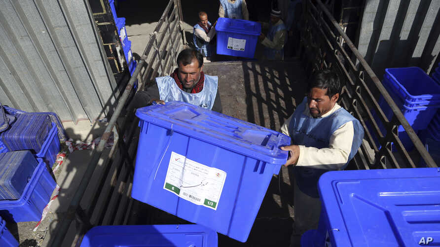 In this Monday, Sept. 23, 2019 photo, Afghan election workers load ballot boxes and other election materials on a truck for distribution at the Independent Election Commission compound, in Kabul, Afghanistan. Millions of Afghans are expected to go…