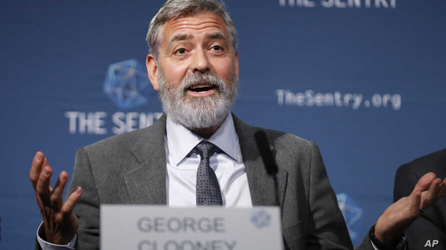 "US actor and activist George Clooney speaks at a press conference about South Sudan in London, Thursday, Sept. 19, 2019. The largest multinational oil consortium in South Sudan is ""proactively participating in the destruction"" of the country, the…"