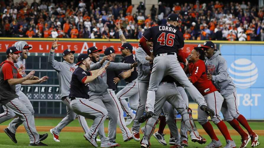 The Washington Nationals celebrate after Game 7 of the baseball World Series against the Houston Astros Wednesday, Oct. 30,…