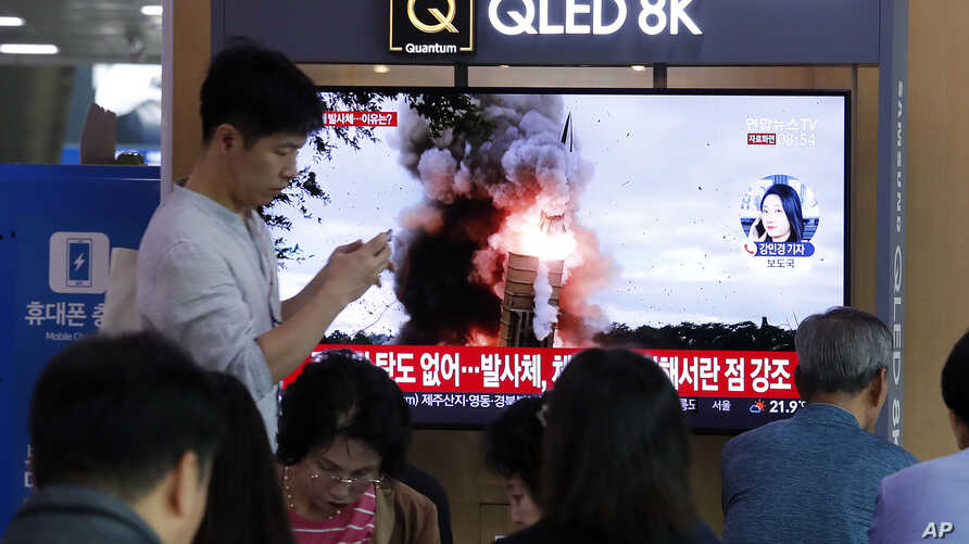 People watch a TV showing a file image of North Korea's missile launch during a news program at the Seoul Railway Station in Seoul, South Korea, Wednesday, Oct. 2, 2019. North Korea on Wednesday fired projectiles toward its eastern sea, South Korea…