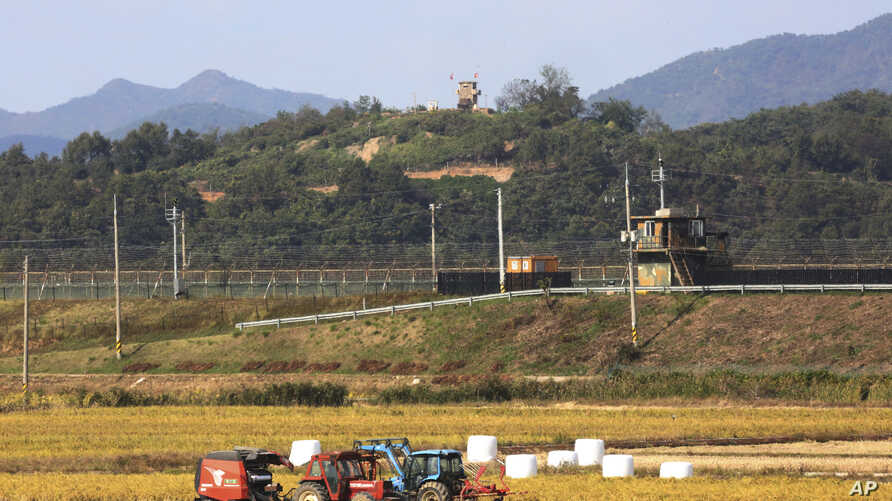 Military guard posts of North Korea, top, and South Korea, center, are seen in Paju, South Korea, near the border with North…