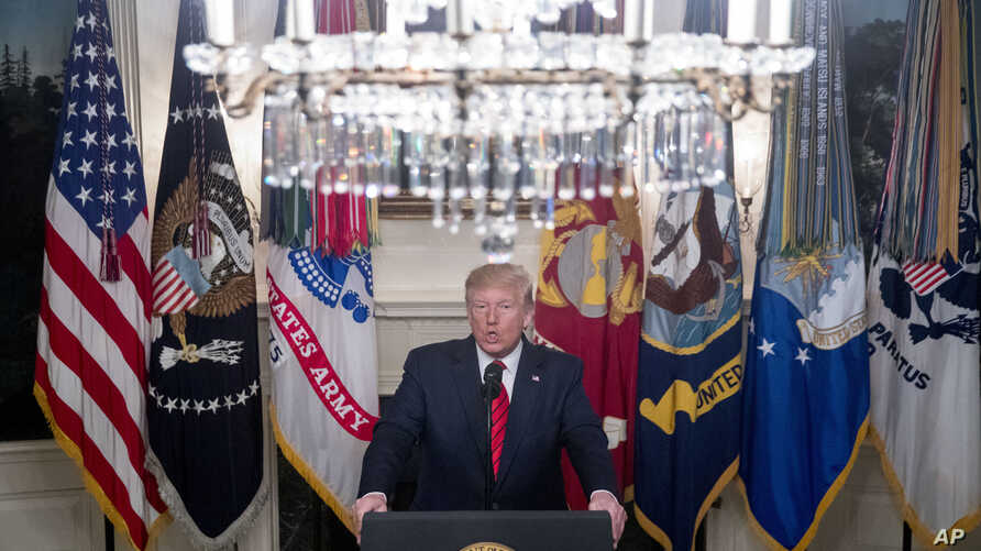 President Donald Trump speaks in the Diplomatic Room of the White House