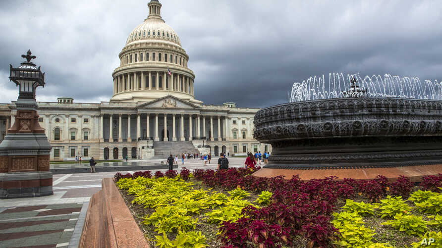 FILE- In this May 30, 2018, file photo the East Front of the U.S. Capitol in Washington is seen under stormy skies. On Tuesday,…