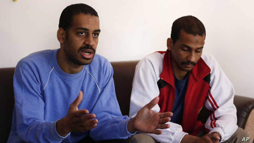 "FILE - In this March 30, 2019, photo, Alexanda Amon Kotey, left, and El Shafee Elsheikh, who were allegedly among four British jihadis who made up a brutal IS cell dubbed ""The Beatles,"" speak with The Associated Press"