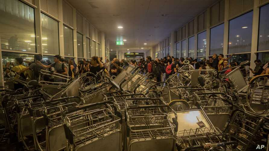 Trolleys block an entrance at El Prat airport, outskirts of Barcelona, Spain, Monday, Oct. 14, 2019. Spain's Supreme Court on…