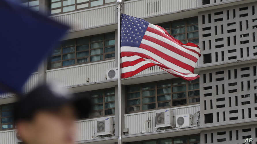 A South Korean police officer stands guard near the U.S. embassy in Seoul, South Korea, Thursday, June 27, 2019. North Korea…