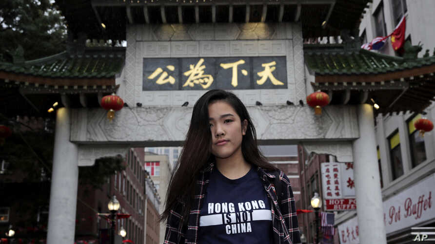 Emerson College student Frances Hui poses in the Chinatown neighborhood of Boston, Wednesday, Oct. 2, 2019. Tensions over Hong Kong have been flaring at campuses around the world that host large numbers of visiting Chinese students. Hui, of Hong…