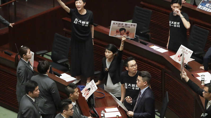 Pro-democracy lawmakers protest as Hong Kong Chief Executive Carrie Lam delivers a speech at chamber of the Legislative Council…