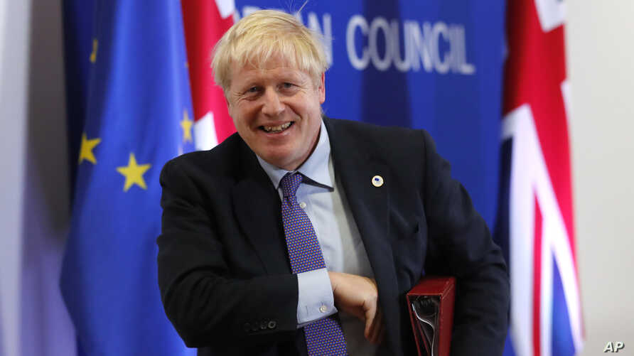 British Prime Minister Boris Johnson leaves the podium after addressing a media conference at an EU summit in Brussels,…