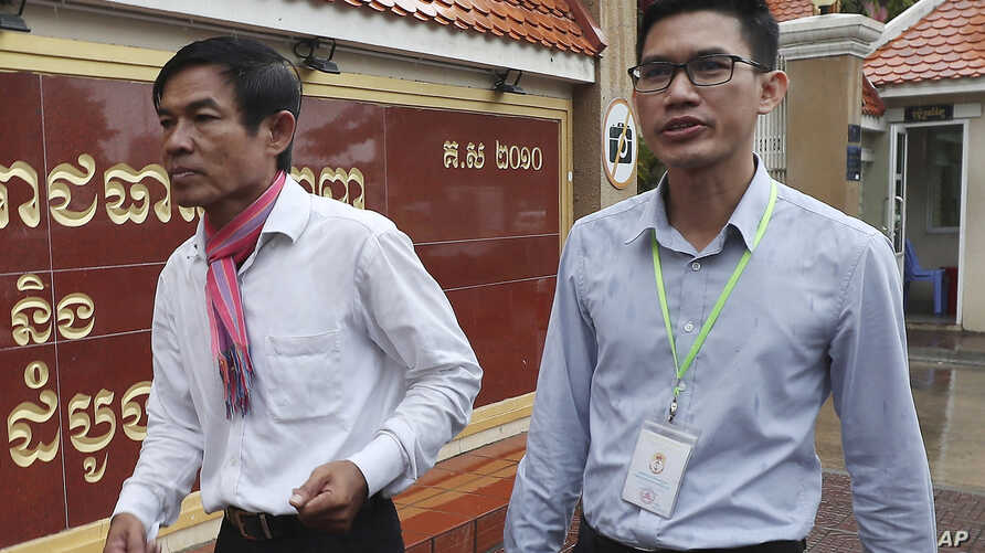 Journalists Uon Chhin, left, and Yeang Sothearin arrive at the municipal court in Phnom Penh, Cambodia, Friday, Aug. 30, 2019. A verdict has been delayed in the espionage case against the two Cambodian journalists who worked for the U.S. government…