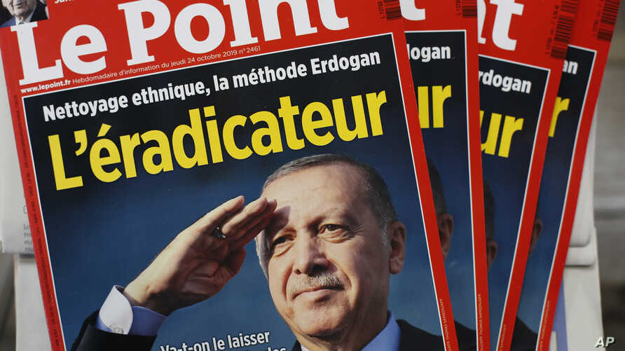 The cover of Le Point, a French weekly political magazine, featuring Turkish President Recep Tayyip Erdogan and the headline …