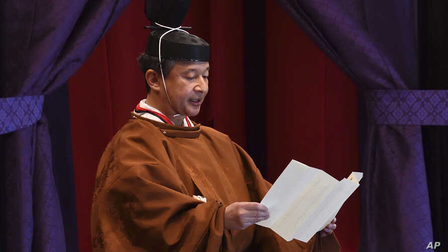 Emperor Naruhito delivers his speech during the enthronement ceremony
