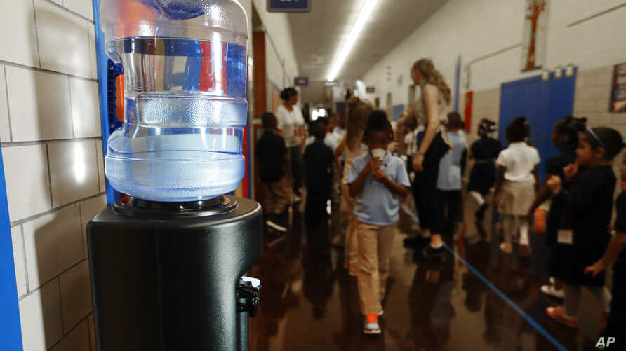 A bottled water dispenser sits in a hallway at Gardner Elementary School in Detroit, Tuesday, Sept. 4, 2018. Some 50,000…