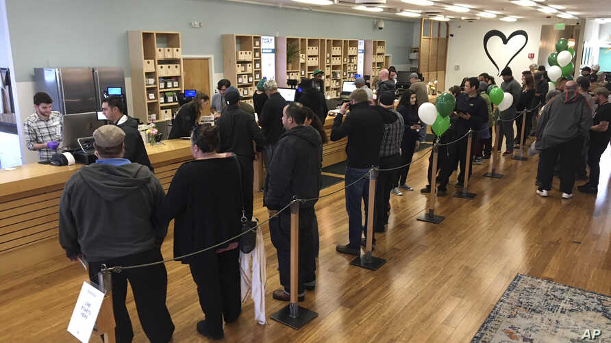 FILE - In this Jan. 4, 2018, file photo, customers line up inside the Harborside cannabis dispensary in Oakland, Calif…