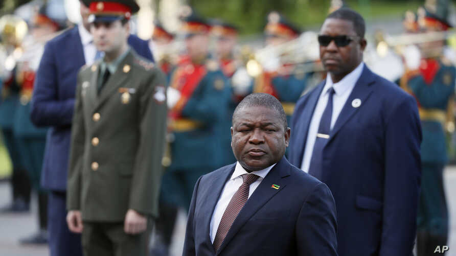 President of Mozambique Filipe Nyusi, centre, attends a wreath laying ceremony at the Tomb of the Unknown Soldier in Moscow,…