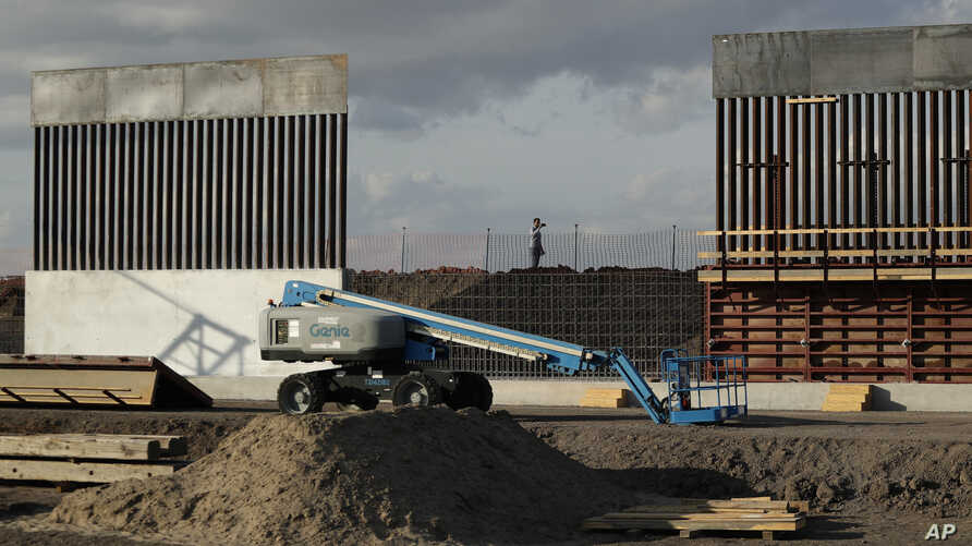 The first panels of levee border wall are seen at a construction site along the U.S.-Mexico border, Thursday, Nov. 7, 2019, in…