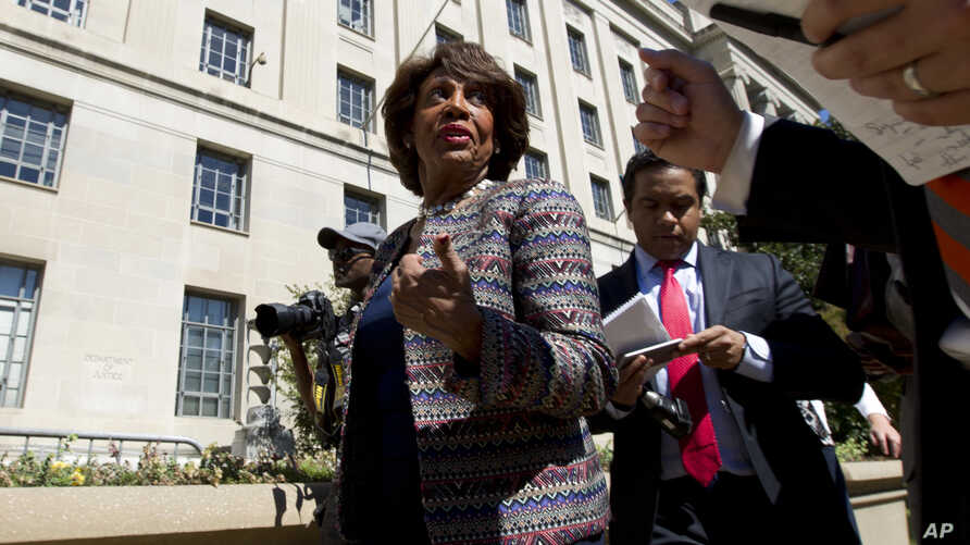 FILE - In this Sept. 22, 2016 file photo, Rep. Maxine Waters D-Calif., accompanied by other members of the Congressional Black…