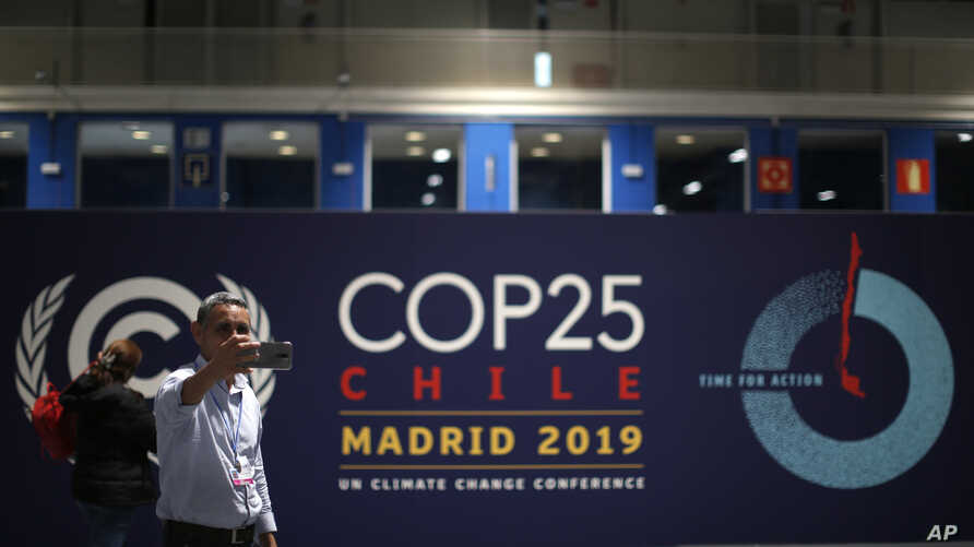 A participant takes a selfie ahead of the Climate Summit COP25 in Madrid, Spain, Friday, Nov. 29, 2019. The Climate Summit…