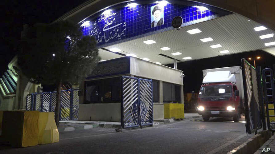 In this photo released on Wednesday, Nov. 6, 2019 by the Atomic Energy Organization of Iran, a truck containing cylinder of…