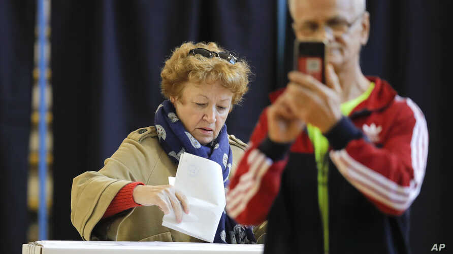 A woman casts her vote in Bucharest, Romania