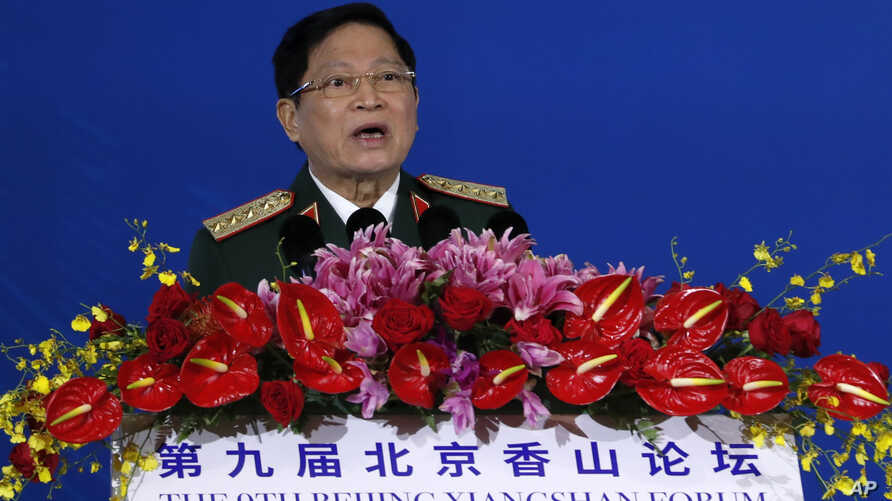 Vietnam's Defense Minster General Ngo Xuan Lich speaks at the Xiangshan Forum, a gathering of the region's security officials,…