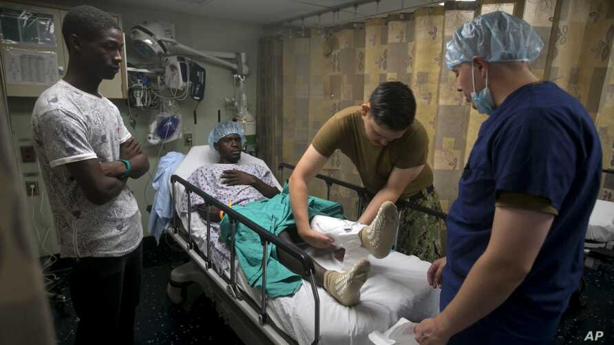 A man gets free medical attention on the U.S. Navy's hospital ship USNS Comfort anchored off Port-au-Prince, Haiti, Friday, Nov…