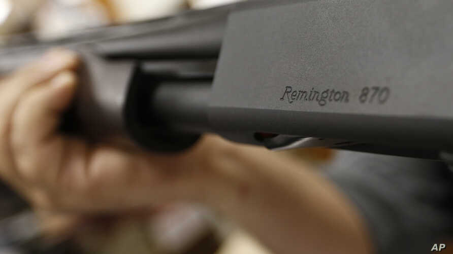 FILE - In this March 1, 2018 file photo, the Remington name is seen etched on a model 870 shotgun at Duke's Sport Shop in New…