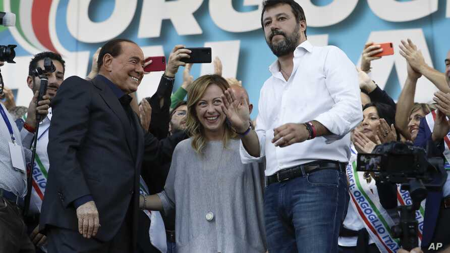 From left, Silvio Berlusconi, Giorgia Meloni and Matteo Salvini address a rally in Rome, Saturday, Oct. 19, 2019. Thousands of…