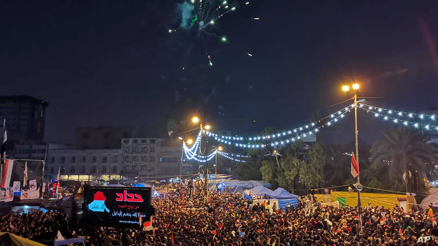 Anti-government protesters shoot fireworks in Tahrir Square, Baghdad, Iraq, Friday, Nov. 29, 2019.  Celebrations have erupted…