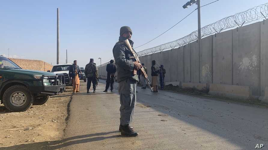 Security stand guard near the site of attack near the Bagram Air Base in Parwan province of Kabul, Afghanistan, Wednesday, Dec…