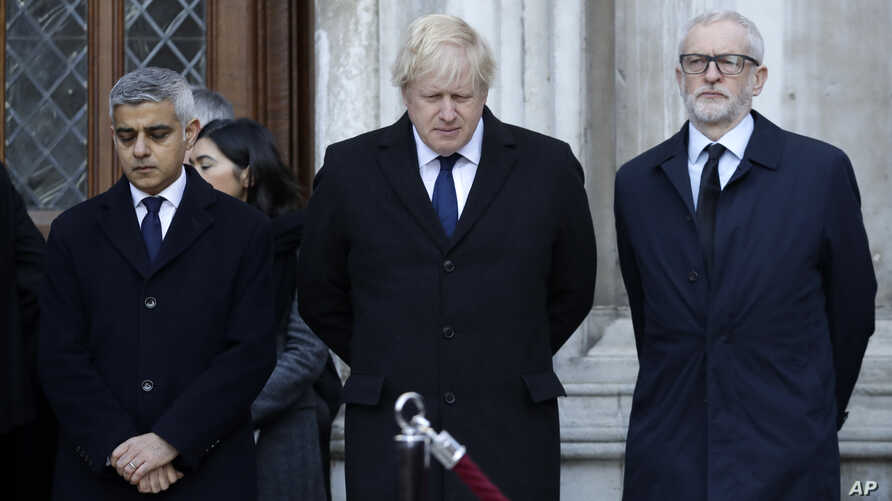 Britain's Prime Minister Boris Johnson, center, Labour Party leader Jeremy Corbyn, right, and Mayor of London Sadiq Khan take…