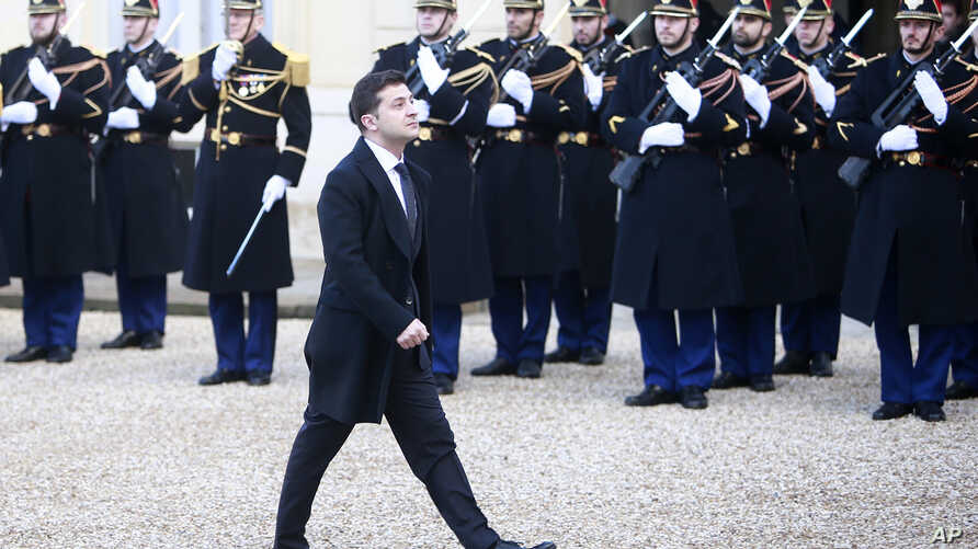 Ukrainian President Volodymyr Zelenskiy arrives to the Elysee Palace, Monday, Dec. 9, 2019 in Paris. The leaders of Russia,…