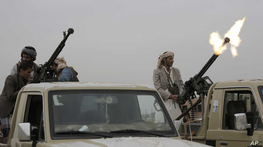 A Houthi rebel fighter fires in the air during a gathering aimed at mobilizing more fighters for the Houthi movement, in Sanaa,…