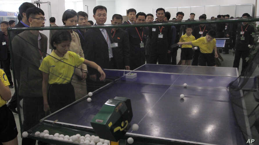 Table tennis practice equipment is on display during the 23rd National Exhibition of Sports Scientific and Technological…