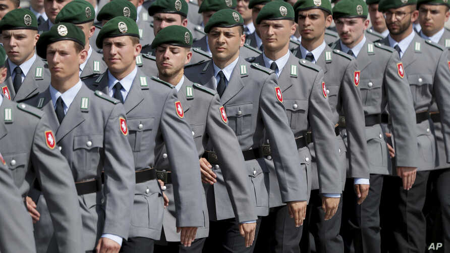 In this Saturday, July 20, 2019 photo soldiers attend an oath-taking ceremony of the German army at the Defence Ministry in…