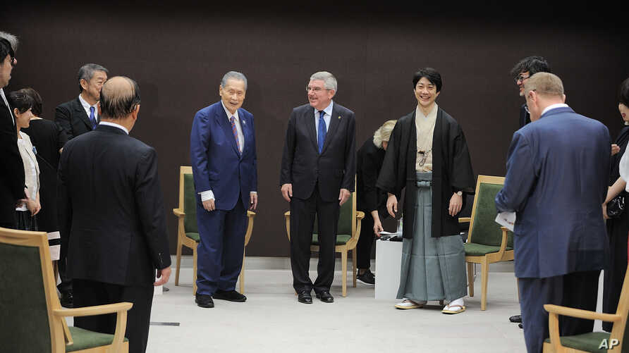 International Olympic Committee (IOC) President Thomas Bach, center right, and Tokyo 2020 President Yoshiro Mori, center left,…