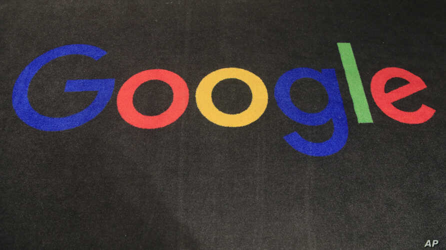 The logo of Google is seen on a carpet at the entrance hall of Google France in Paris, Monday, Nov. 18, 2019. (AP Photo/Michel…