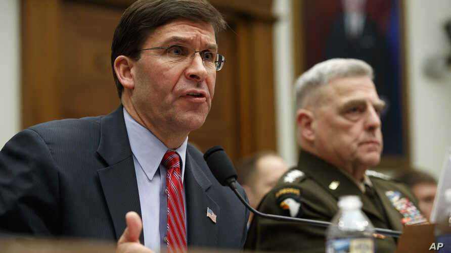 Secretary of Defense Mark Esper, left, and Chairman of the Joint Chiefs Gen. Mark Milley, testify to a House committee hearing…