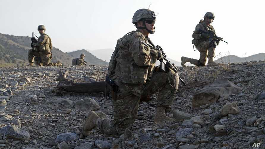 Staff Sgt. Joshua White, center, Command Sgt. Maj. John Troxell, left, and Brigade Sgt. Maj. Mike Boom, right, observe a joint…