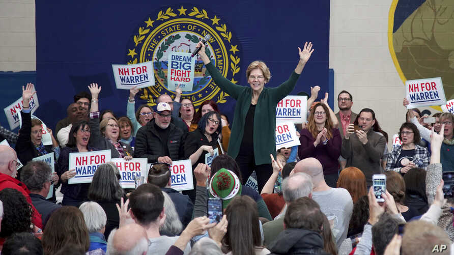 Democratic presidential candidate Sen. Elizabeth Warren, D-Mass., reacts as she takes the stage during a campaign stop,…